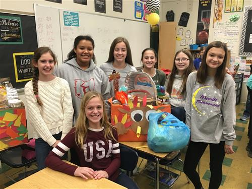 Claggett Seventh Grade Students Building Thanksgiving Food Baskets
